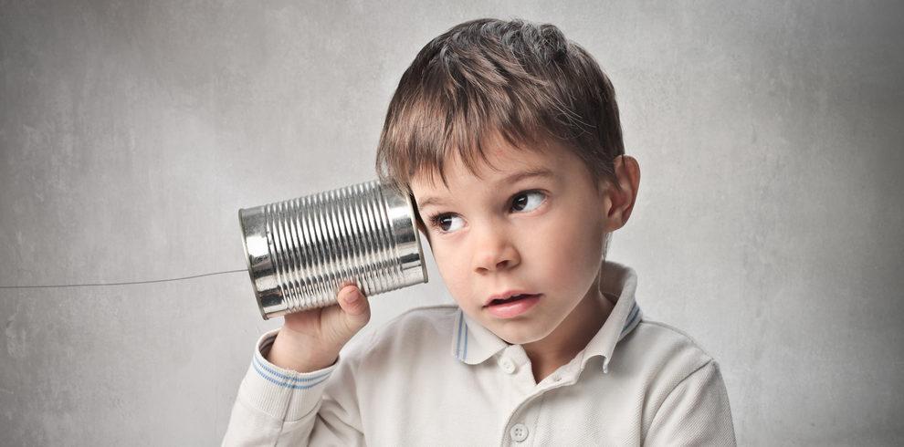 boy listening through can